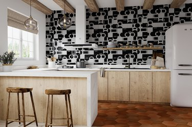 kitchen area with wood cabinets and black and white tile backsplash