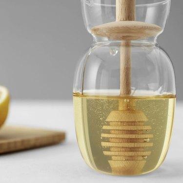 honey dipper in jar of honey