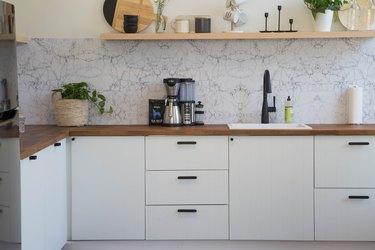 kitchen with marble tile backsplash