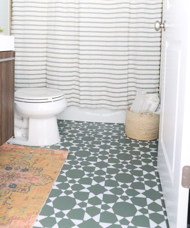 bathroom with teal and white patterned floor