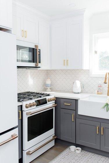 white and gray farmhouse kitchen with fish scale tile backsplash