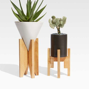 two geometric planters on wooden stands