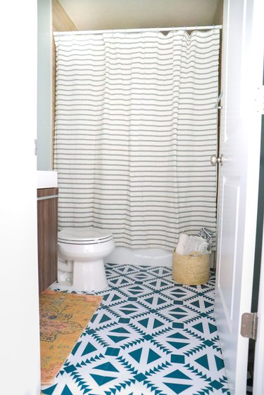 bathroom with patterened floor tile