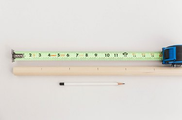 Measure and mark the dowel rod into 3-inch sections.