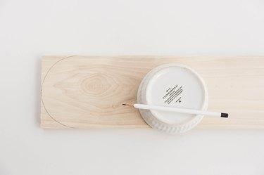 Trace your ramekin on the edge of the wood board.