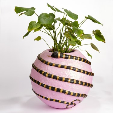 pink snake planter in the shape of a sphere from block shop