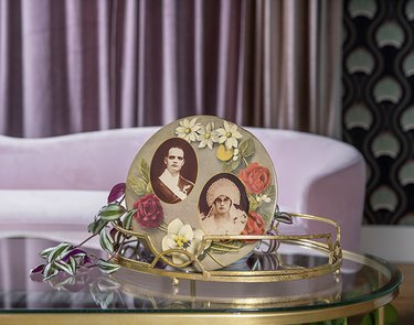 Portraits in frame on coffee table in Monica Orozco's living room
