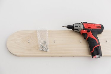 Drill screws up through the back of the wood board.