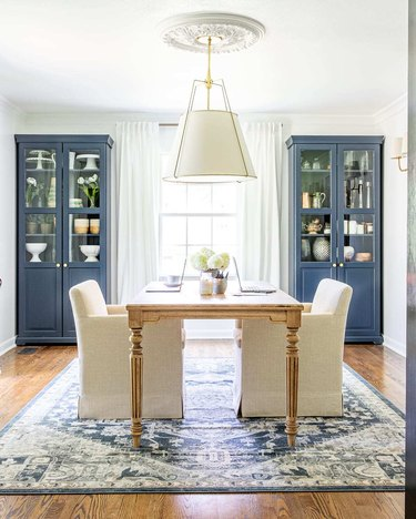 class home office with dining table and pendant light with drum shade