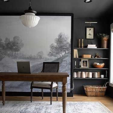 vintage home office with mural and milk glass pendant light