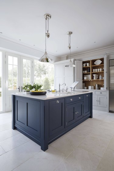 engineered stone kitchen countertops with blue cabinetry