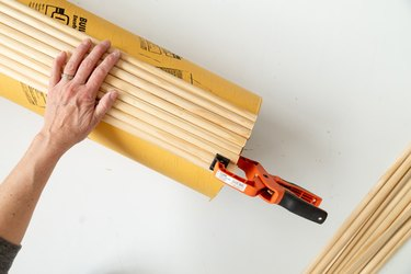 adding wood dowels to a tube for table DIY
