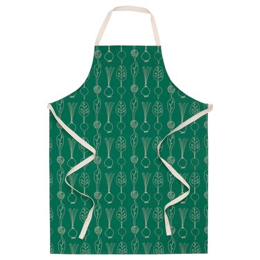 green and white vegetable pattern apron