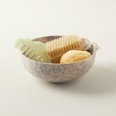 soapstone bowl with bathroom accessories