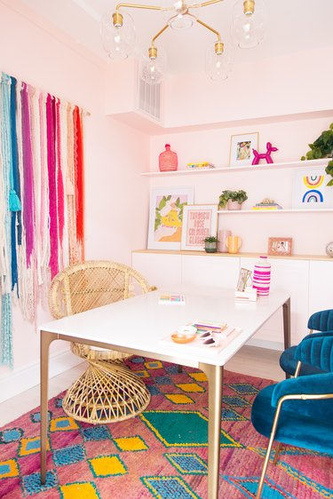 a colorful office with rainbow wall hanging