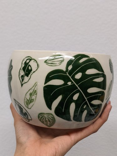 ceramic piece with leaf drawings