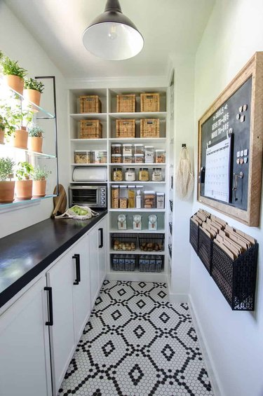 black and white butler's pantry with patterned tile floor and built-in shelving