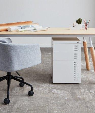 white file cabinet under desk in office