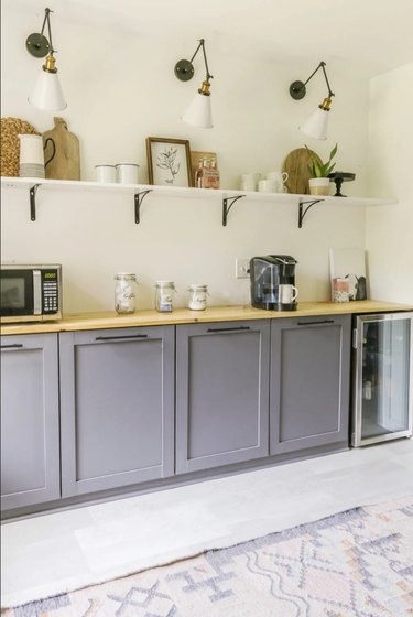 modern butler's pantry with lavender cabinets and open shelving
