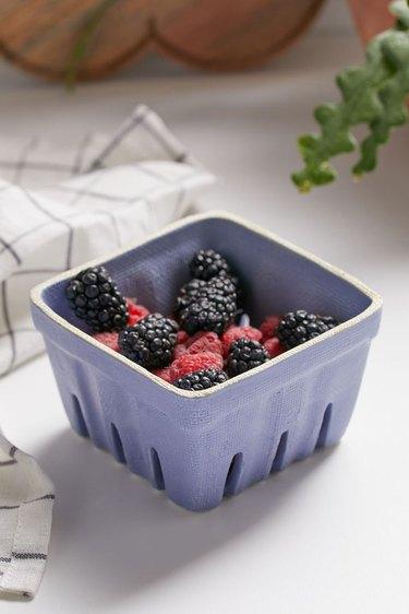 berries in ceramic colander