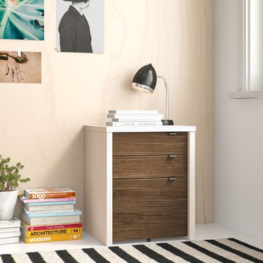 white and wood finish file cabinet with stainless steel pulls