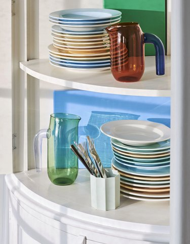 shelves with colorful plates and pitchers