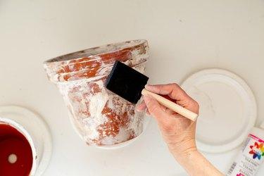 applying sealer to DIY aged terra cotta pots