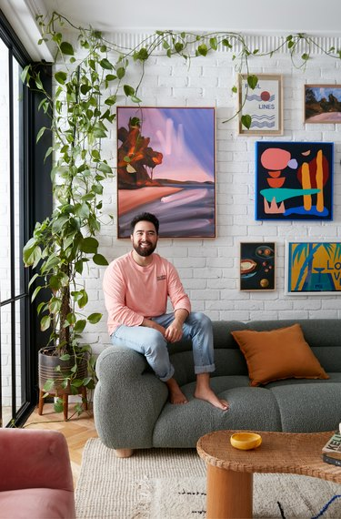 designer Jono Fleming sitting on sofa in living room
