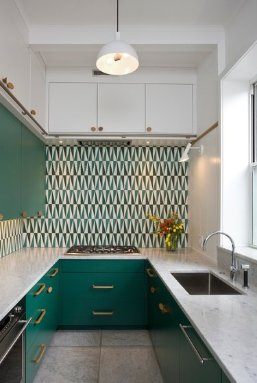 geometric green and white kitchen backsplash in two tone kitchen