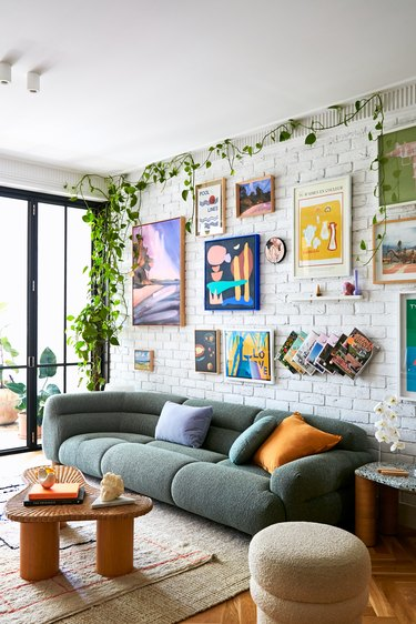 Jono Fleming living room with curved sofa and gallery wall
