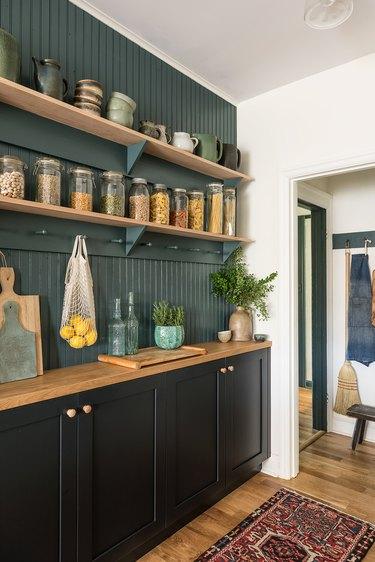 green kitchen with green beadboard splashback