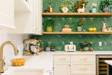 green and white hex tile splashback in modern kitchen