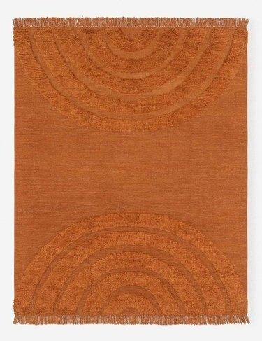 burnt orange rug with arch detailing