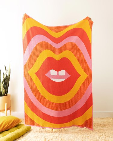 blanket with colorful pattern and lips