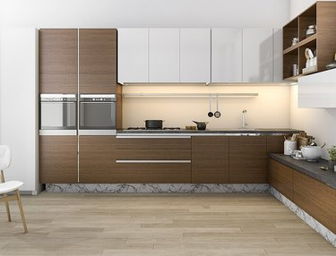 Kitchen with dark wood bamboo cabinets, wood floors.