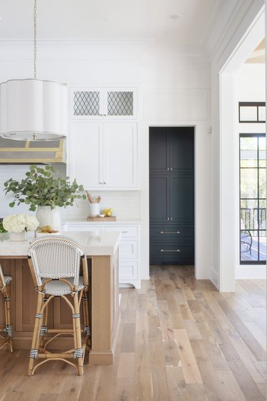 all white traditional kitchen with white cabinets and leaded glass panels