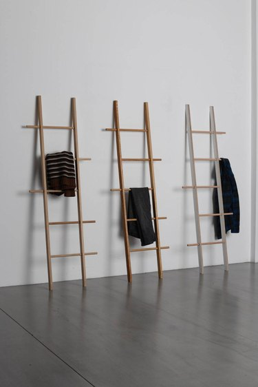three clothes ladders