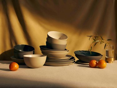 stacked ceramic dinnerware with yellow gold backdrop