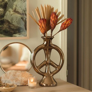 peace shaped bronze colored vase from jungalow