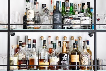 alcohol bottles on metal shelves