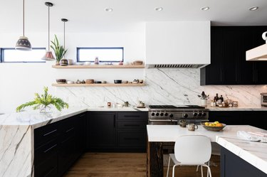 black and white kitchen with granite countertop