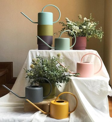 pastel colored gardening pitchers from etsy shop