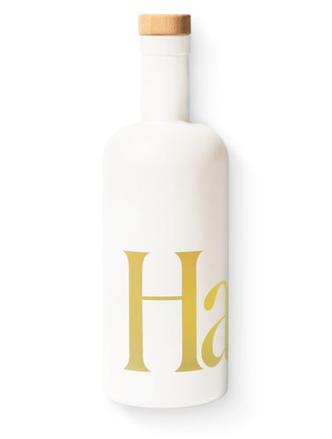 white bottle with yellow text