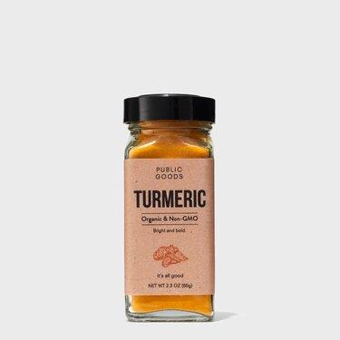 public goods powdered turmeric in spice jar