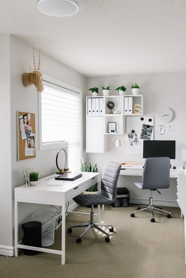 modern home office with white wall shelf and minimalist decor