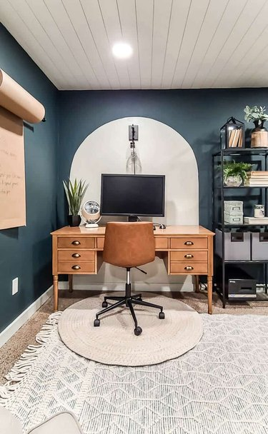 bohemian basement office with painted wall arch and shiplap ceiling