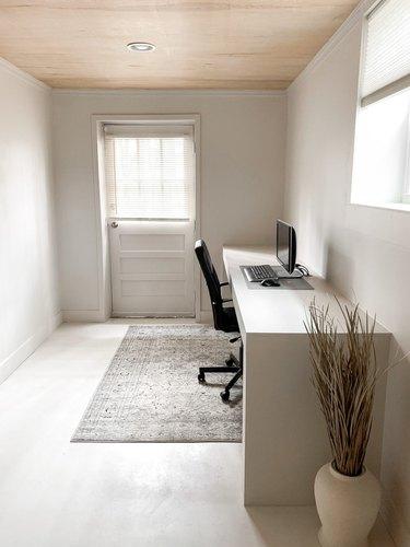 minimalist basement office with walkout and modern desk