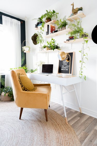 wood shelving arrangement filled with greenery and decor