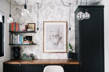 black floating shelves in corner of black and white modern office