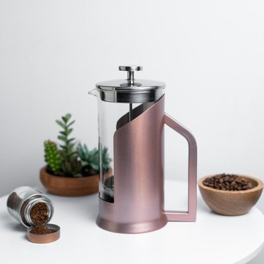 lafeeca pink glass french press on white table